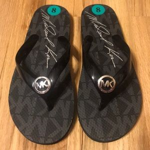 Michael Kors black flip flops